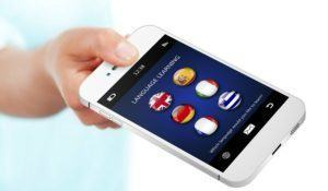 hand holding mobile phone with language learning application over white background