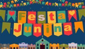 Latin American holiday, the June party of Brazil, bright night the background with colonial houses, church, lights and colored flags and the inscription in Portuguese Festa Junina