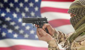 Man with gun in hand and national flag on background series - United States