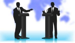 debate people at a microphone on not a sharp background of the p