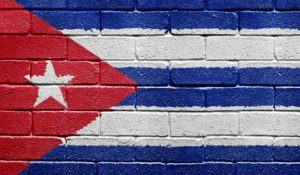 Flag of Cuba painted onto a grunge brick wall