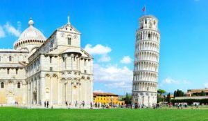 Tourist visiting the leaning tower of Pisa , Italy