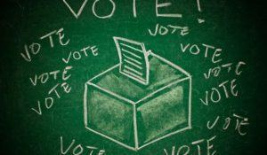 Vote concept; handdrawn ballot box on a green chalkboard