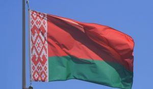 Belarus flag on blue sky, close up