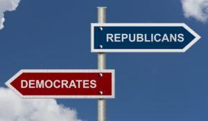 Red and blue street signs with blue sky with words Republicans and Democrats, Republicans versus Democrats