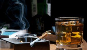 whisky and cigarettes, unhealthy lifestile, lonely drinking at night