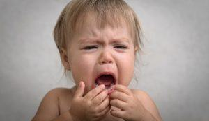 drama with creaming crying baby portrait very emotional